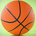 Basketball Ball Over A Green Background by G J