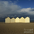 Beach Huts Under A Stormy Sky In Normandy by Bernard Jaubert