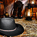 Black Cowboy Hat In An Old Barn by Olivier Le Queinec