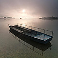 Boat on foggy lake Print by Davorin Mance