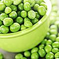 Bowl of green peas Print by Elena Elisseeva