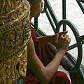 Buddhist Monk Leaning Against A Pillar Sule Pagoda Central Yangon Myanar by Ralph A  Ledergerber-Photography