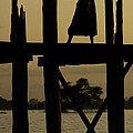 Buddhist Monk Walking Over U Bein's Bridge At Sunset by Ruben Vicente