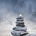 Cairn And Stormy Sky by Colin and Linda McKie