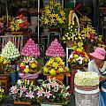 Cambodia Flower Seller by Mark Llewellyn