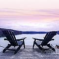 Chairs on lake dock Print by Elena Elisseeva