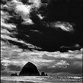 Clouds Over Haystack Rock On Cannon Beach by David Patterson