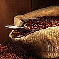 Coffee Beans In Burlap Sack by Sandra Cunningham