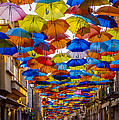 Colorful Floating Umbrellas by Marco Oliveira