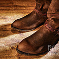 Cowboy Boots On Saloon Floor by Olivier Le Queinec