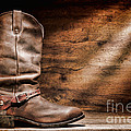 Cowboy Boots On Wood Floor by Olivier Le Queinec