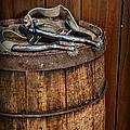Cowboy Spurs On Wooden Barrel by Paul Ward