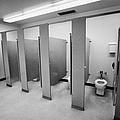 cubicle toilet stalls in womens bathroom in a High school canada north america by Joe Fox