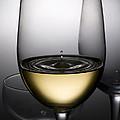 Drops Of Wine In Wine Glasses by Setsiri Silapasuwanchai