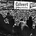 Fans In The Bleachers During A Baseball Game At Yankee Stadium by Underwood Archives