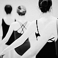 Female Teenage Ballet Students Holding On To A Ballet Barre At A Ballet School In The Uk by Joe Fox