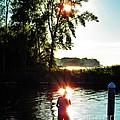 Fisherman In Sunfire by Judy Via-Wolff