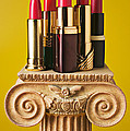 Five Red Lipstick Tubes On Pedestal by Garry Gay