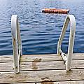 Footprints On Dock At Summer Lake by Elena Elisseeva