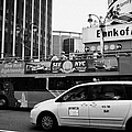 Gray Line New York Sightseeing Bus And Yellow Mpv Taxi Cab On 7th Avenue New York City by Joe Fox