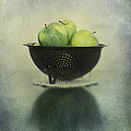 Green Apples In An Old Enamel Colander by Priska Wettstein