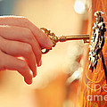 Hand with key Print by Konstantin Sutyagin