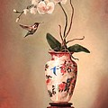 Hummingbird And White Orchid by Lori  McNee