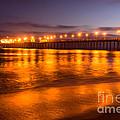 Huntington Beach Pier At Night by Paul Velgos