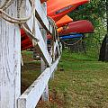 Kayaks On A Fence by Michael Mooney