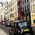 London Taxi On Shopping Street by Elena Elisseeva