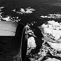 Looking Out Of Aircraft Window Past Engine And Over Snow Covered Fjords And Coastline Of Norway Euro by Joe Fox