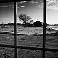 looking out through door window to snow covered scene in small rural village of Forget Saskatchewan  Print by Joe Fox