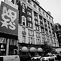 Macys Department Store Broadway Entrance With Yellow Cabs Taxi And Traffic Outside New York City by Joe Fox