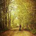 Man Walking  On A Lonely Country Road by Sandra Cunningham