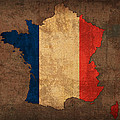 Map of France With Flag Art on Distressed Worn Canvas Print by Design Turnpike