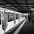 modern yellow u-bahn train sitting at station platform Berlin Germany by Joe Fox