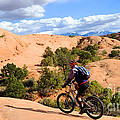 Mountain Biking Moab Slickrock Trail - Utah by Gary Whitton