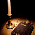 Old Bible And Candle by Olivier Le Queinec