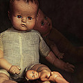 Old Dolls Sitting On Wooden Table by Sandra Cunningham