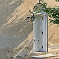 Old Door And Stucco Wall by Olivier Le Queinec