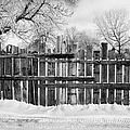 old patched up wooden fence using old bits of wood in snow Forget Saskatchewan  by Joe Fox
