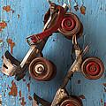 Old roller skates Print by Garry Gay