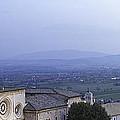 Panoramic View Of Assisi At Night by Susan  Schmitz