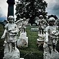 Parade Of Angels Statues At Cemetery by Amy Cicconi