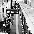 passengers along ubahn train platform Friedrichstrasse Friedrichstrasse u-bahn station Berlin by Joe Fox