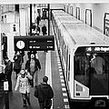 passengers on ubahn train platform as train leaves Friedrichstrasse u-bahn station Berlin Germany by Joe Fox