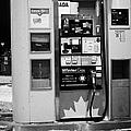 petro canada winter gas fuel pump at service station Regina Saskatchewan Canada by Joe Fox