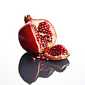Pomegranate Opened Up On Reflective Surface by Johan Swanepoel