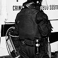 Psni Officer With Riot Gear On Crumlin Road At Ardoyne Shops Belfast 12th July by Joe Fox