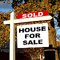 Real Estate Sold And House For Sale Sign On Post by Olivier Le Queinec